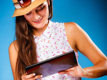 Girl using tablet computer e-book reader. Royalty Free Stock Photography