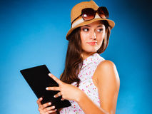 Girl using tablet computer e-book reader. Royalty Free Stock Photos