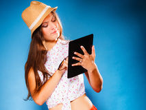 Girl using tablet computer e-book reader. Royalty Free Stock Images