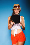 Girl using tablet computer e-book reader. Stock Photo
