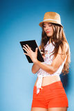Girl using tablet computer e-book reader. Stock Photography