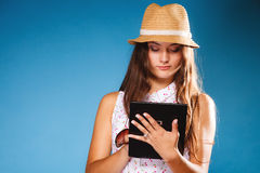 Girl using tablet computer e-book reader. Stock Images