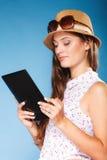 Girl using tablet computer e-book reader. Stock Image
