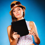 Girl using tablet computer e-book reader. Royalty Free Stock Image
