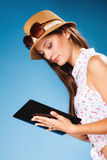 Girl using tablet computer e-book reader. Technology internet modern lifestyle concept. Young summer girl using tablet computer reading. Latin female with e Stock Photo