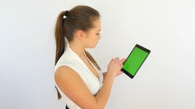Girl Using Tablet with Green Screen. Business Woman Touching Tablet with Ggreen Screen stock footage