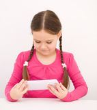 Girl using tablet. Happy little girl using tablet Royalty Free Stock Image