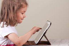 Girl using a tablet Stock Photo