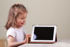Girl using a tablet Royalty Free Stock Photos