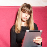 Girl using tablet pc Stock Image
