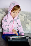 Girl using tablet pc Stock Photo