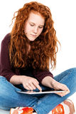 Girl is using tablet pc Stock Images