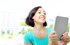 Girl using tablet pc Royalty Free Stock Image