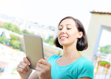 Girl using tablet pc Stock Images