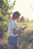 Girl using a tablet pc. Trendy girl using a tablet pc outdoors Stock Photo