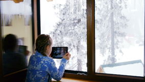 Girl using a tablet. Girl winter forest photographed using a tablet stock video footage