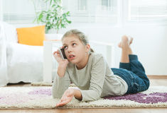 Girl using  telephone Royalty Free Stock Photography