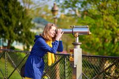 Girl using telescope for sightseeing Stock Image