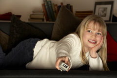 Girl Using Television Remote Control Stock Image