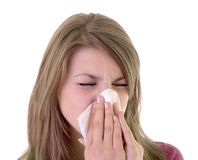 Girl using a tissue Stock Image