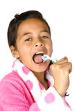 Girl using toothbrush as microphone Royalty Free Stock Photos