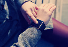 Girl using trendy smart watch Royalty Free Stock Images
