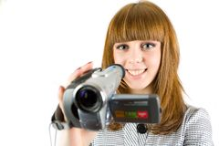 Girl using video camera. (camcorder), isolated on white background Royalty Free Stock Images