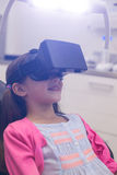 Girl using virtual reality headset during a dental visit Royalty Free Stock Image