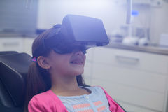 Girl using virtual reality headset during a dental visit Royalty Free Stock Images