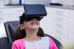 Girl using virtual reality headset during a dental visit. In clinic royalty free stock image