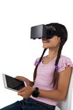 Girl using virtual reality headset and digital tablet Stock Photography