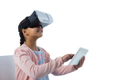 Girl using virtual reality headset and digital tablet Royalty Free Stock Images