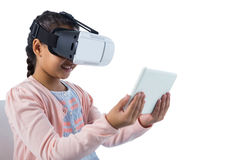 Girl using virtual reality headset and digital tablet Stock Image