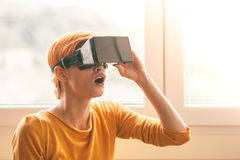 Girl using virtual reality headset Stock Images