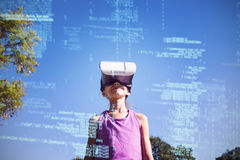 Girl using vr 3d headset in the park Stock Photo