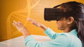 Girl using Vr on DNA background. Digital composite of girl with hands up using VR on orange DNA background stock video footage
