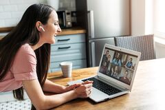 A young woman using laptop for video call, zoom