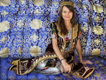 Girl in uzbek national suit Stock Photos