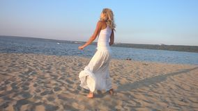 Girl on vacation beach. Young beautiful woman dancing on sand sea shore in slow motion. Girl on vacation beach stock video