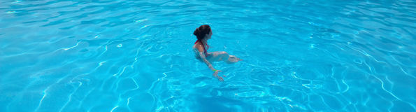 Girl on vacation at the hotel swimming in the pool. Royalty Free Stock Photos