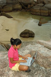 Girl on Vacation Using Laptop Computer Outside Stock Photo
