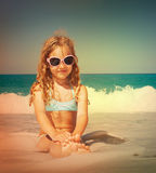 Girl at vacations on sea Stock Images