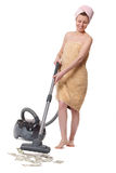 Girl with a vacuum cleaner Royalty Free Stock Image