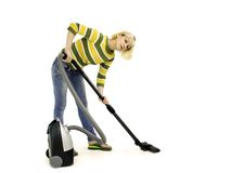 Girl with a vacuum cleaner Royalty Free Stock Photography