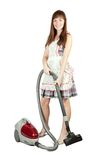 Girl in with vacuum cleaner Stock Image