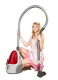 Girl in with vacuum cleaner Stock Photography