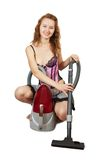 Girl  with vacuum cleaner Royalty Free Stock Images