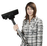 Girl with a vacuum cleaner Stock Images