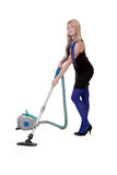 The girl with a vacuum cleaner Stock Image