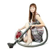 Girl in with vacuum cleaner. Isolated over white background Royalty Free Stock Photography